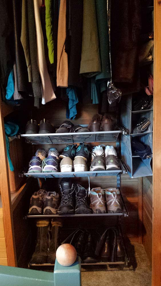 orderly closet with pull-out shoe rack